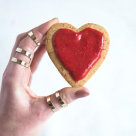 heart-shape whole wheat sugar cookies with strawberry icing