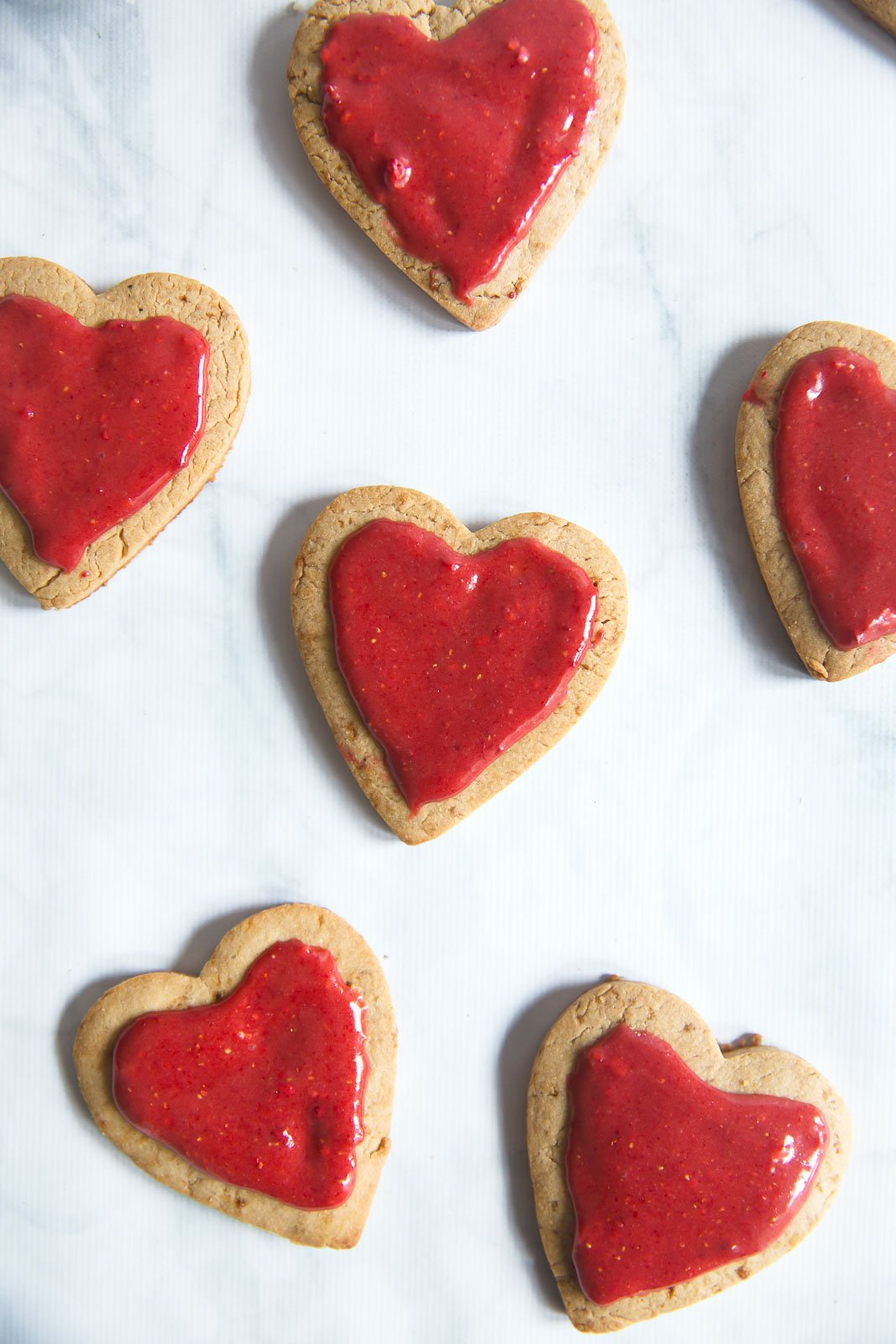 heart-shaped whole wheat sugar cookies with strawberry icing