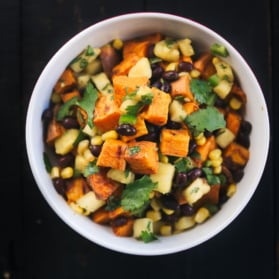 roasted sweet potato salad with black beans and pineapple salsa in a bowl