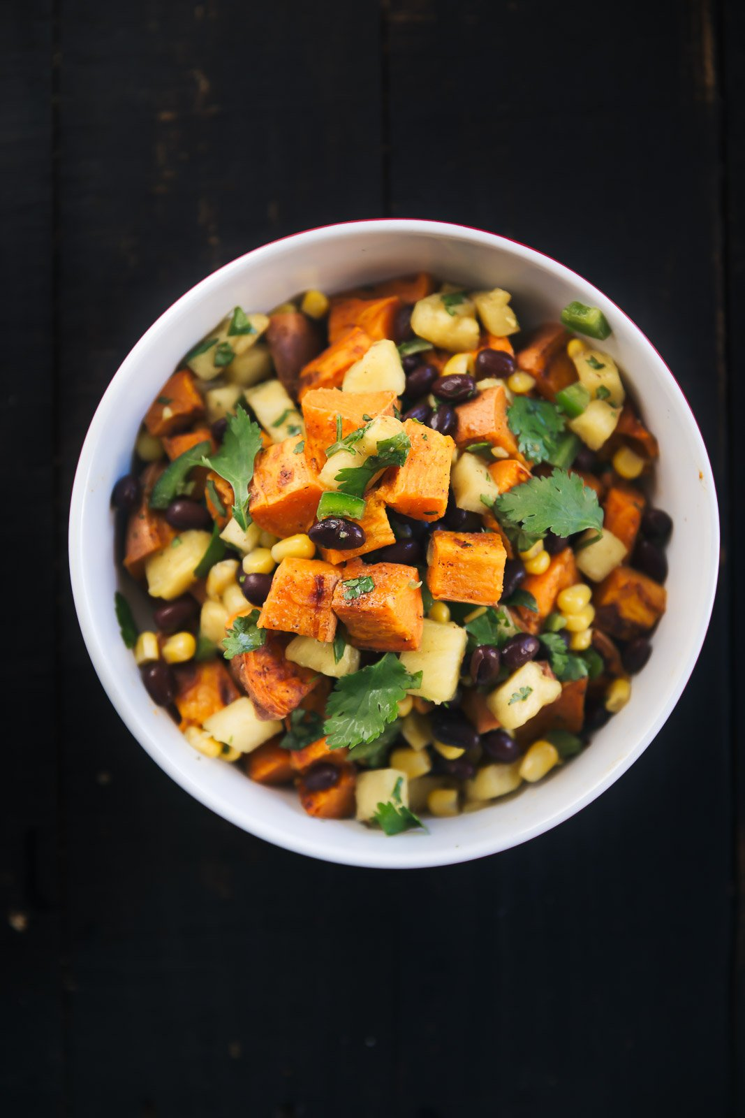 Vegetarian roasted sweet potato salad with black beans & a fresh sweet pineapple corn salsa. Perfect for potlucks & parties.