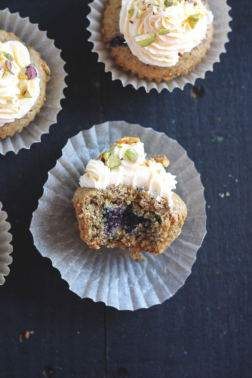 Lemon Blueberry Pistachio Cupcakes with the best fluffy lemon buttercream on the planet! Vegan & Gluten Free!
