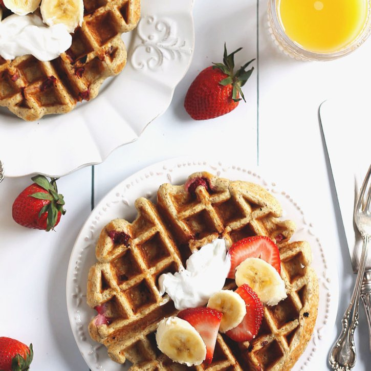 Strawberry Banana Healthy Oatmeal Greek Yogurt Waffles -- protein & fiber packed! The batter is made in the blender for easy clean up.