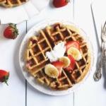 greek yogurt waffle topped with strawberries and banana slices