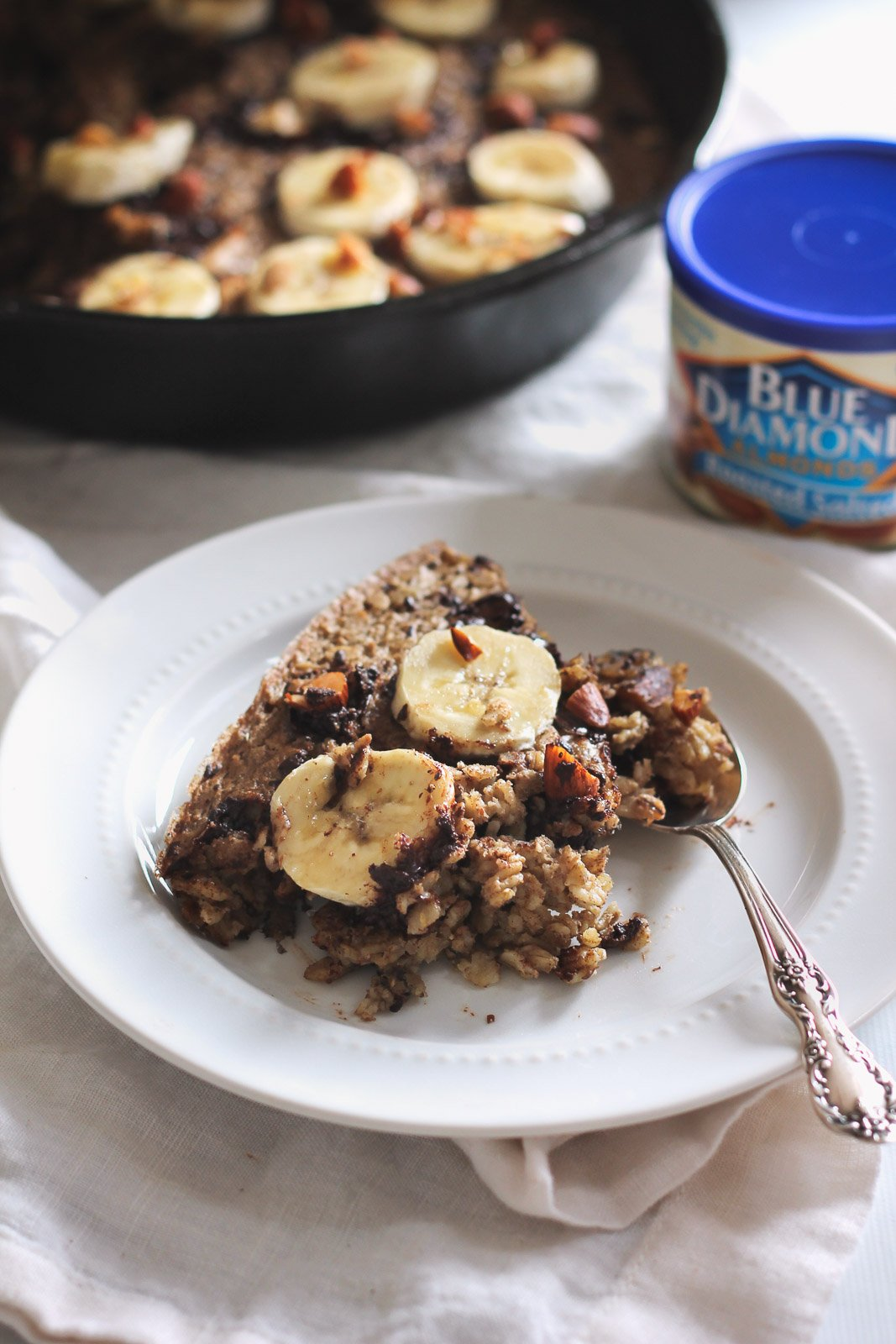 banana baked oatmeal on a plate with a spoon