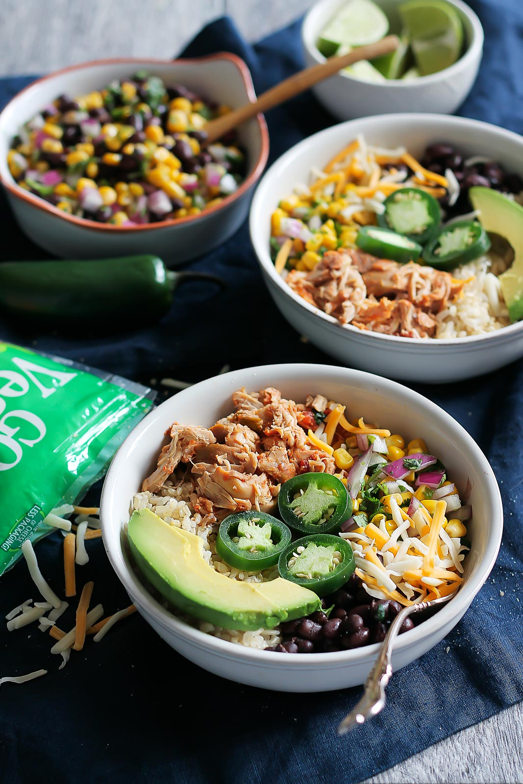 chicken burrito bowls with avocado and jalapeño slices