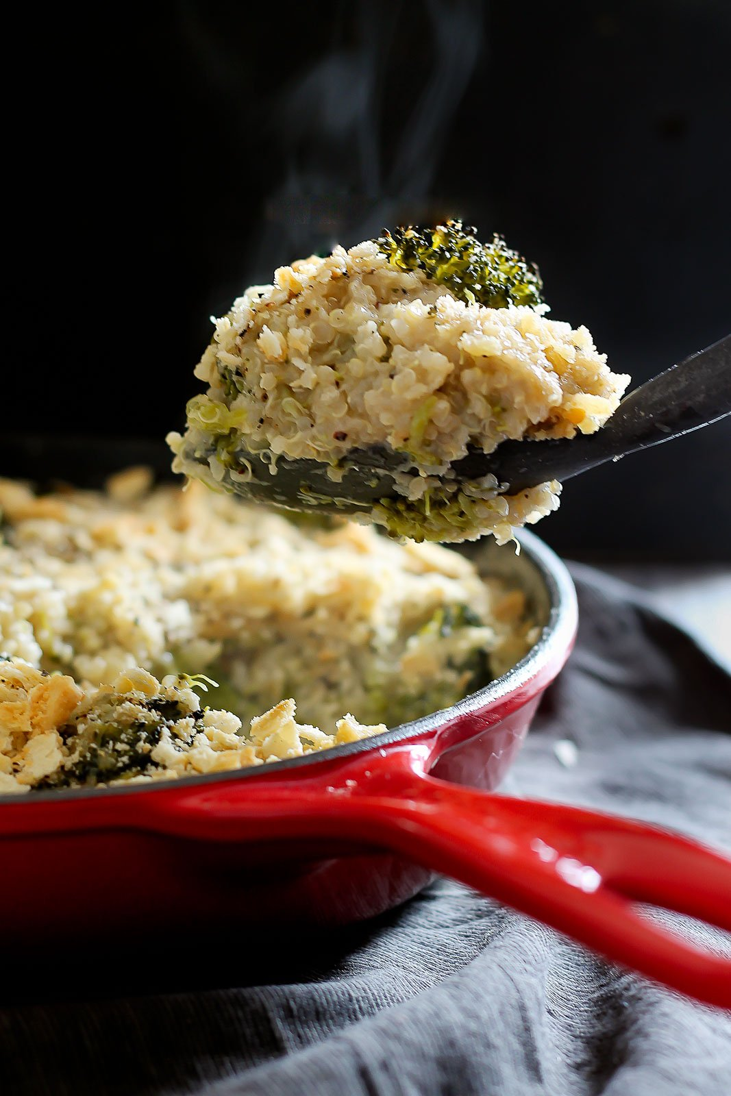 The best comfort food made a little more nutritious & gluten free! Try this quinoa mac and cheese with broccoli, a creamy white cheddar sauce & a cracker crust topping!