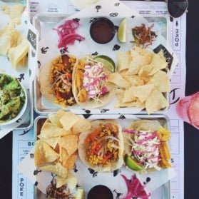 tacos and chips on a table