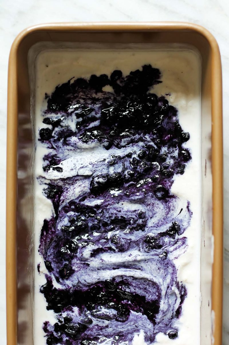 vegan coconut ice cream with blueberry swirls in a rectangle pan