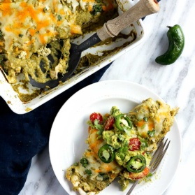 Salsa Verde Chicken Enchiladas on a plate and in a square pan