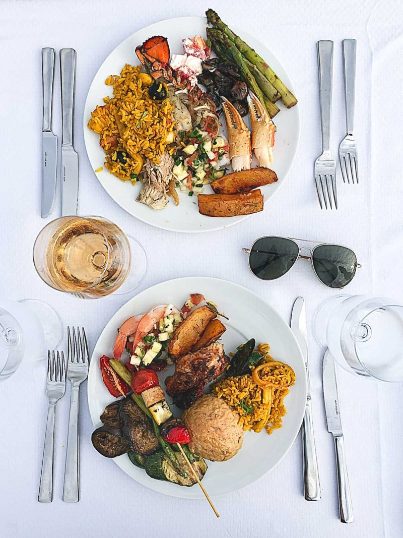 two dinner plates filled with food