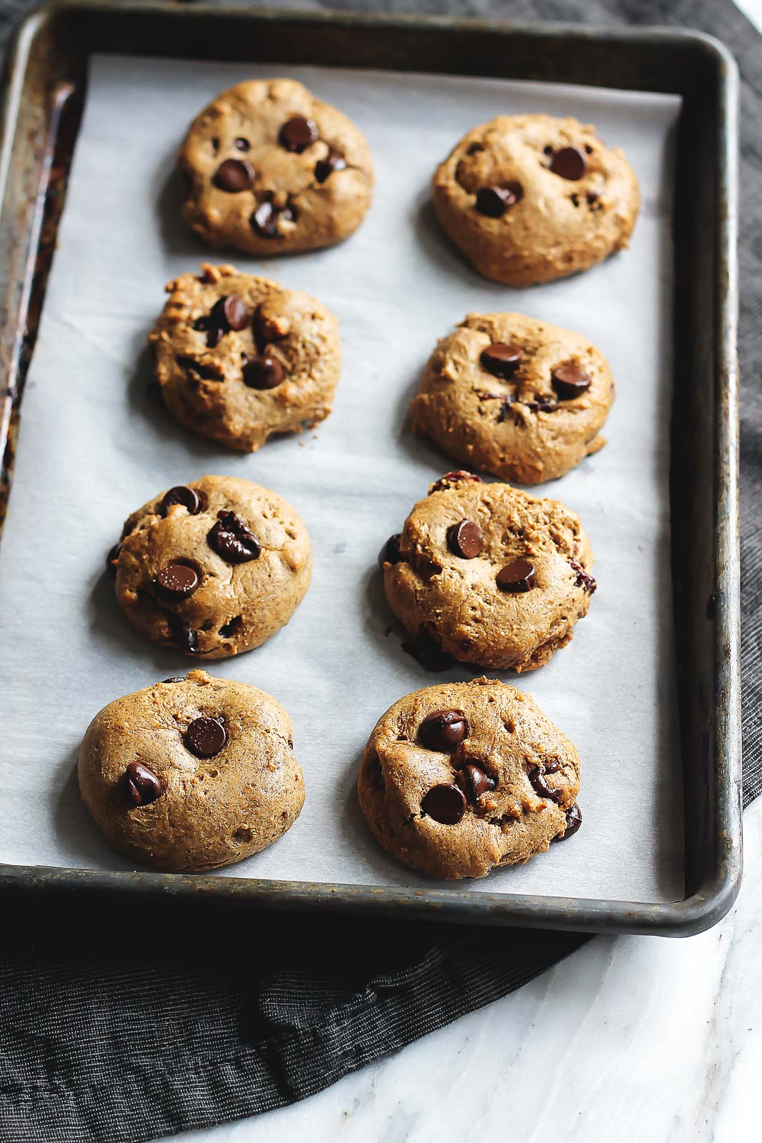 chocolate chip protein cookies on a baking tray