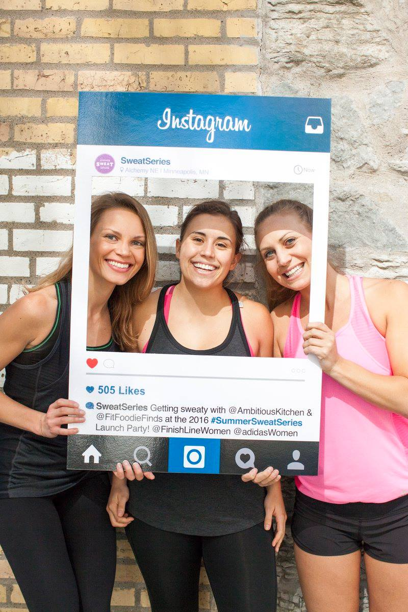 three girls posing in an Instagram poster cutout