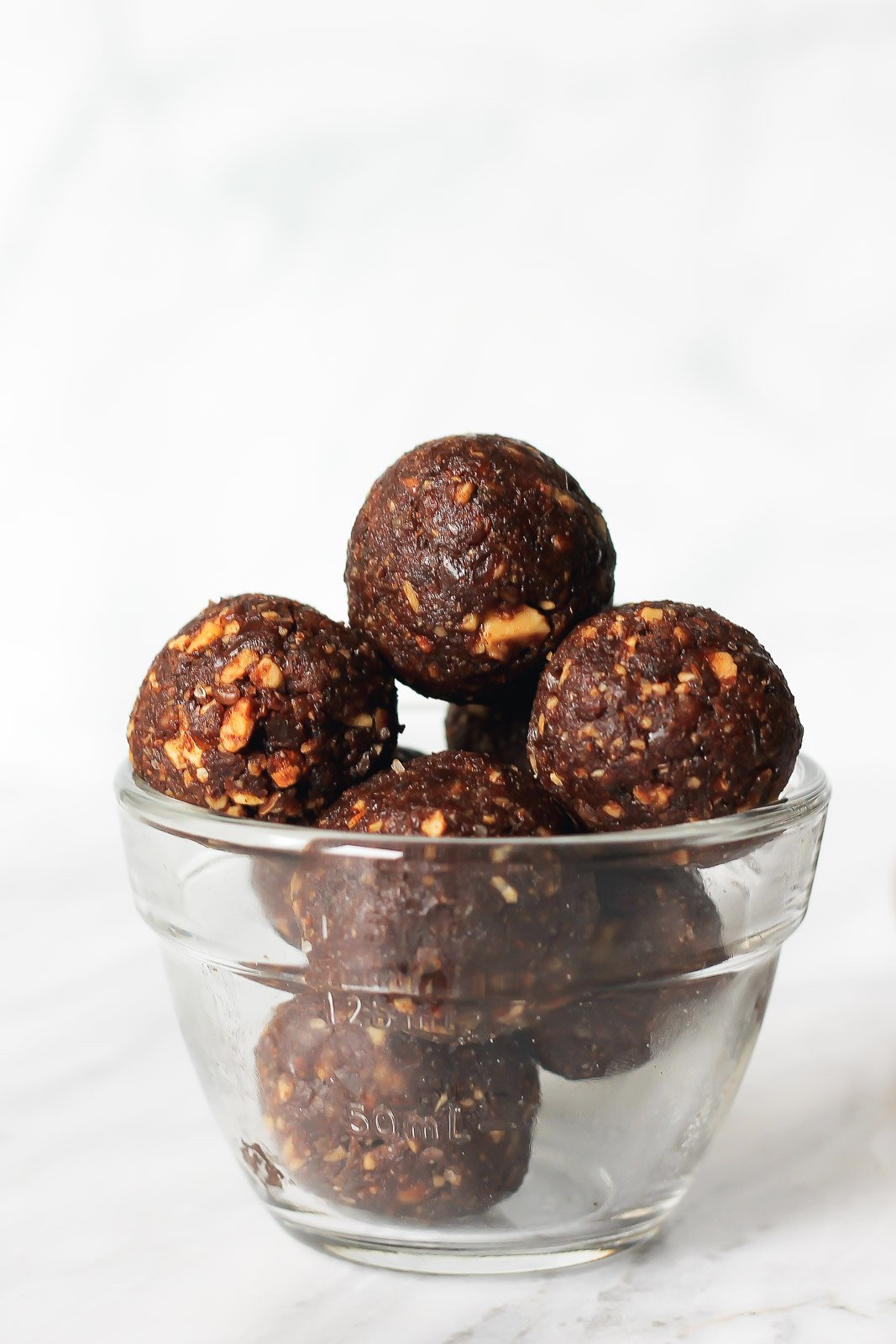You're only 6 ingredients away from these salted date brownie energy bites. They taste just like a chewy, fudge brownie. Roll them in nuts or coconut for a 'truffle' version.