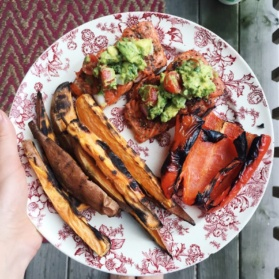 plate with sweet potato fries, salmon, and grilled pepper