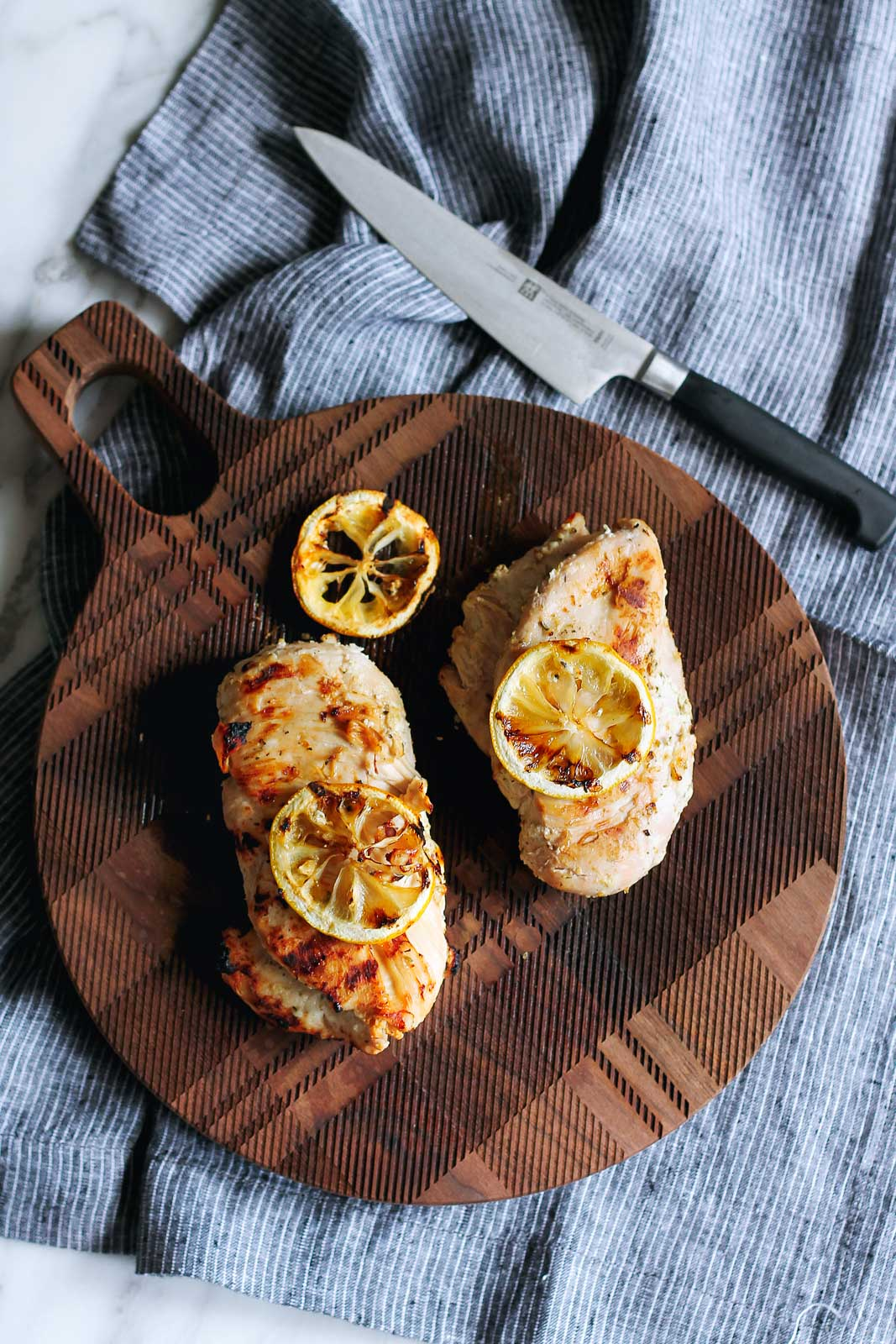 An easy, flavorful lemon and yogurt marinated grilled chicken recipe that keeps the chicken juicy and flavorful! Enjoy over a salad or stuffed in a pita!