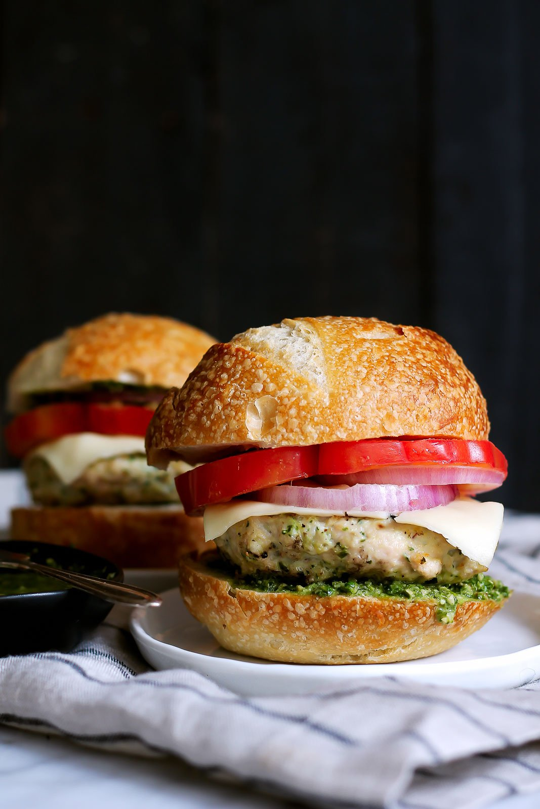 BEST CHICKEN BURGER EVER -- healthy chicken burgers with an easy homemade basil pesto, mozzarella and all the toppings!