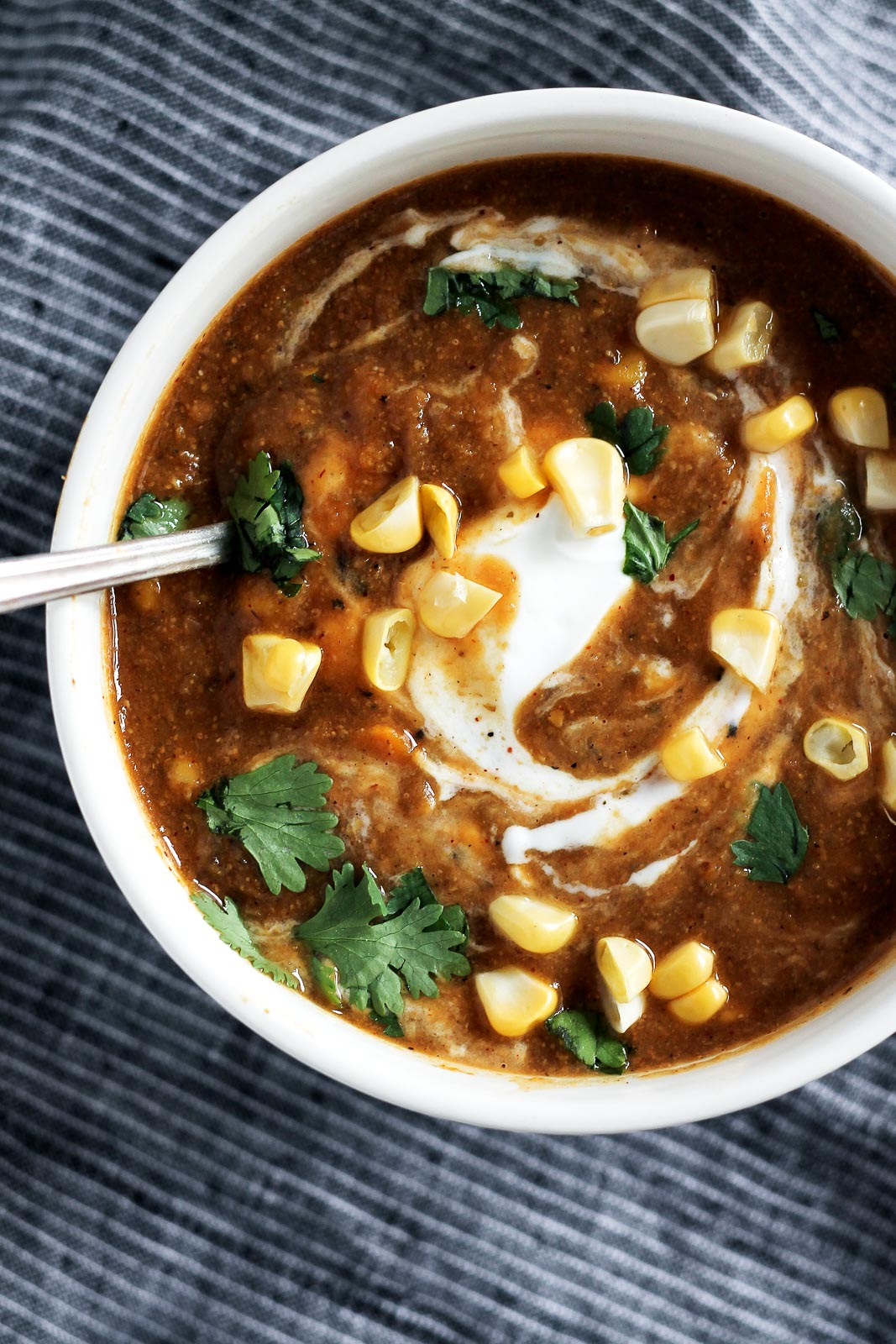 Healthy vegan sweet potato corn chowder with curry spices and a little kick. Comforting, filling and a wonderful way to use up fresh or frozen summer corn!