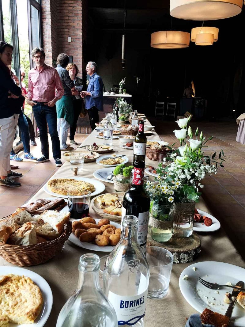 long table of food and wine
