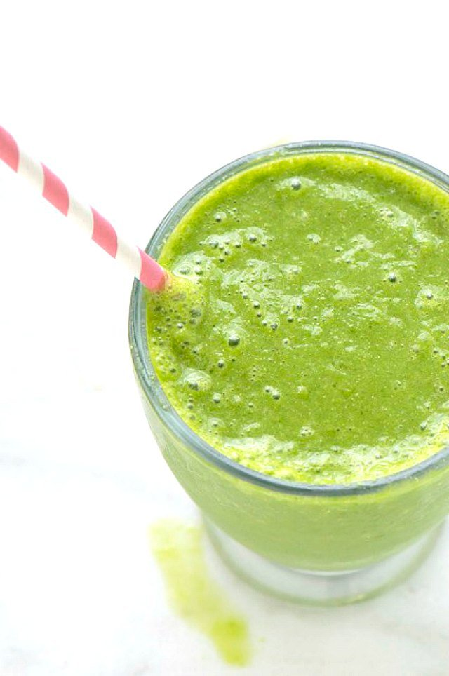 green banana smoothie in a cup
