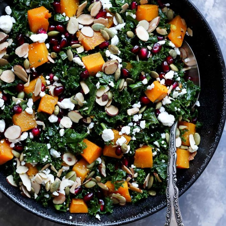 Healthy butternut squash and kale salad with pomegranate, goat cheese and almonds! A great salad during the holiday season. Easy to make and SO delicious!