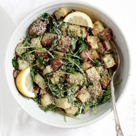 Roasted Garlic Basil Pesto Potatoes with Arugula in a bowl