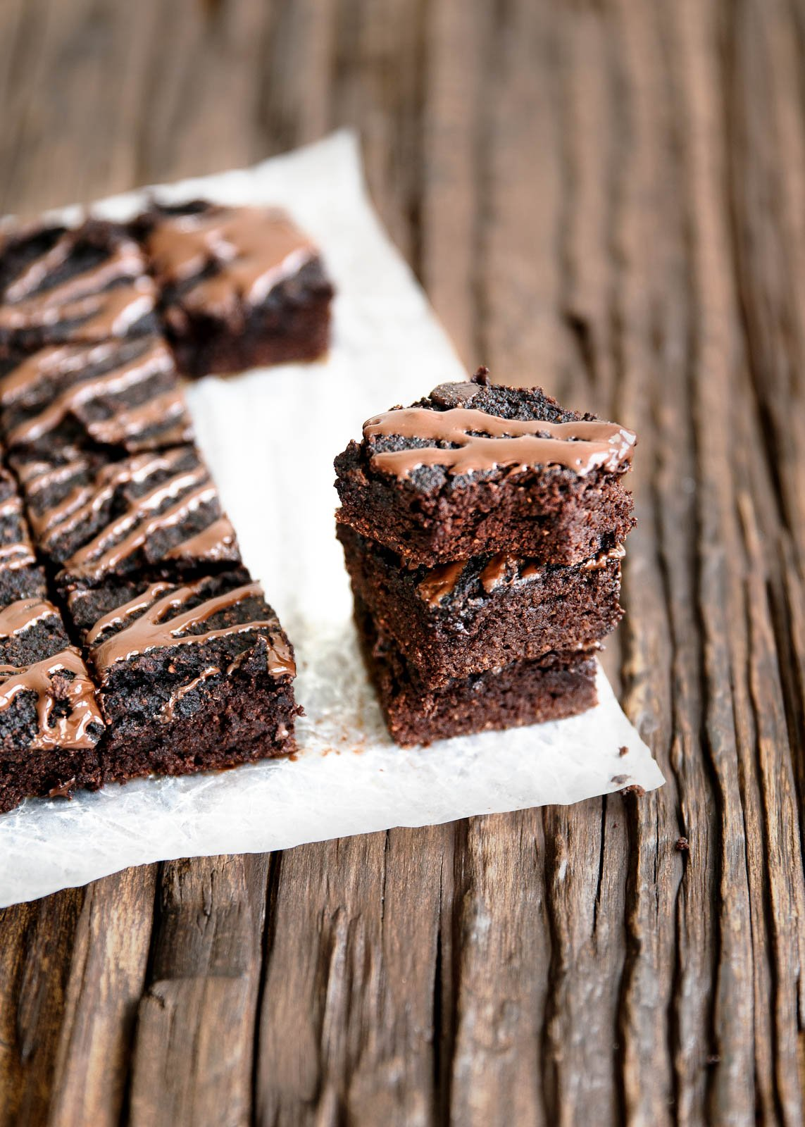 pumpkin paleo brownies on parchment paper