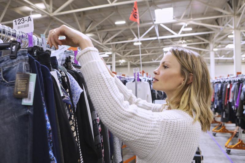 monique shopping a clothing rack