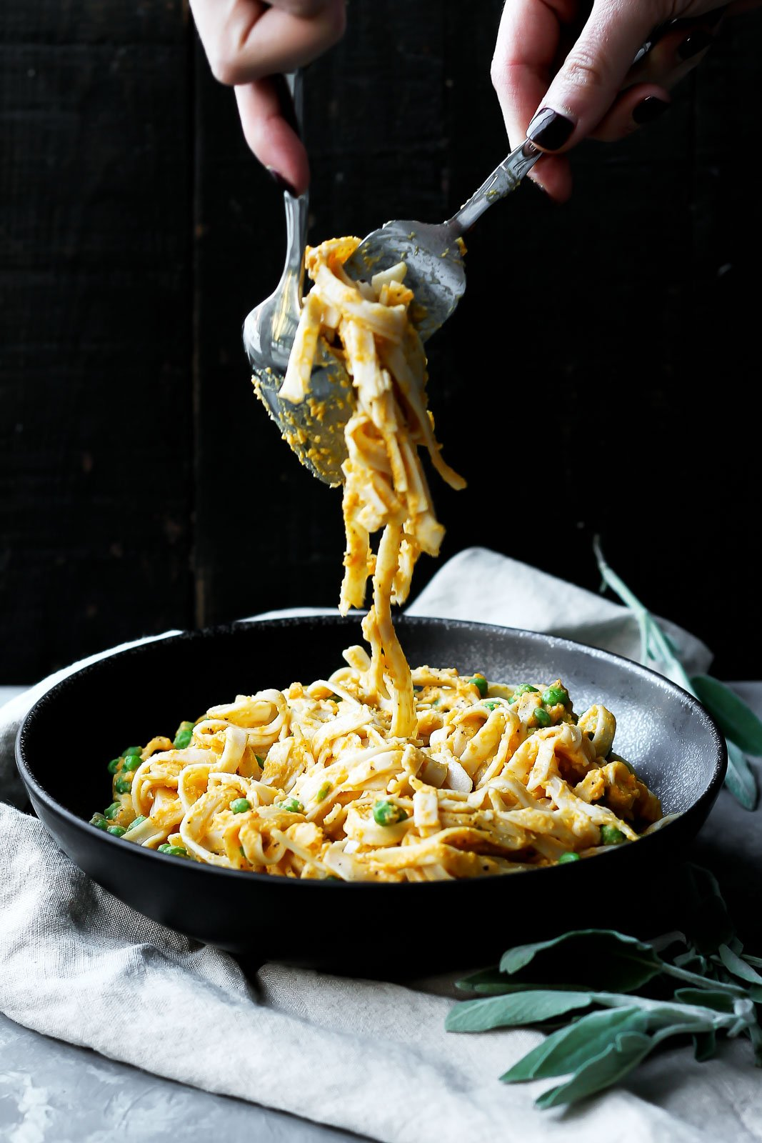 Savory Roasted Butternut Squash Pasta with sweet green peas is the ultimate vegetarian comfort food. The pasta sauce is easy to make and the recipe can easily be vegan and gluten free!