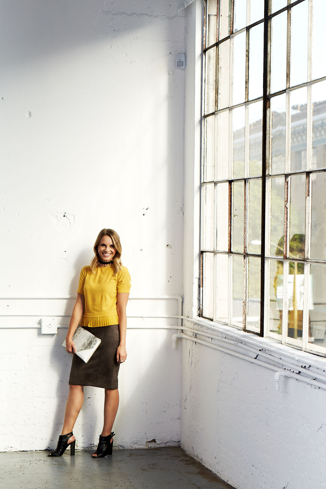 Why not make work outfits fun and a little edgy? Try pairing a colorful top with a suede pencil skirt black heels and a choker!