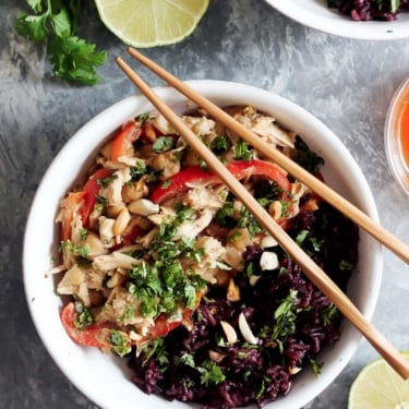 slow cooker thai peanut chicken in a bowl with chopsticks
