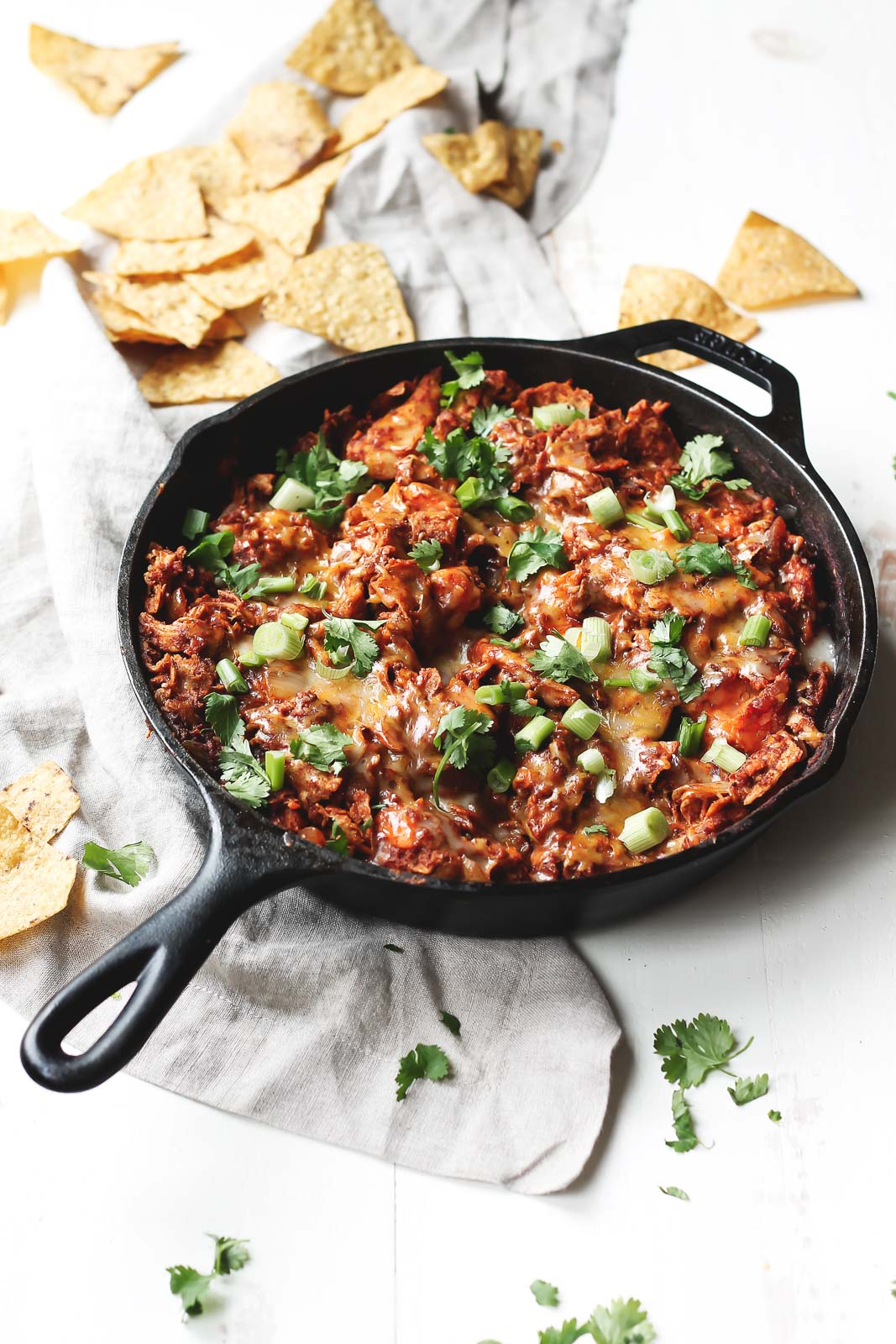Sweet Potato & Turkey Enchilada Skillet next to tortilla chips