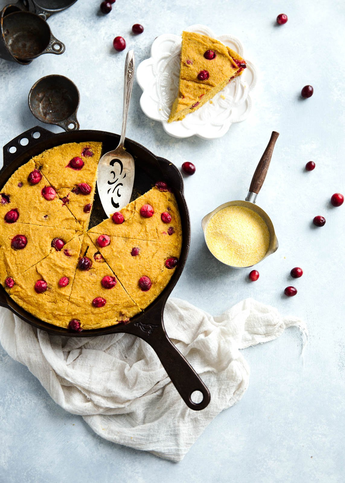 This Pumpkin Cornbread is a lightened up version of traditional cornbread. Made with whole grains, pumpkin, pure maple syrup, speckled with just a hint of brown butter and bursting with juicy, tart cranberries!