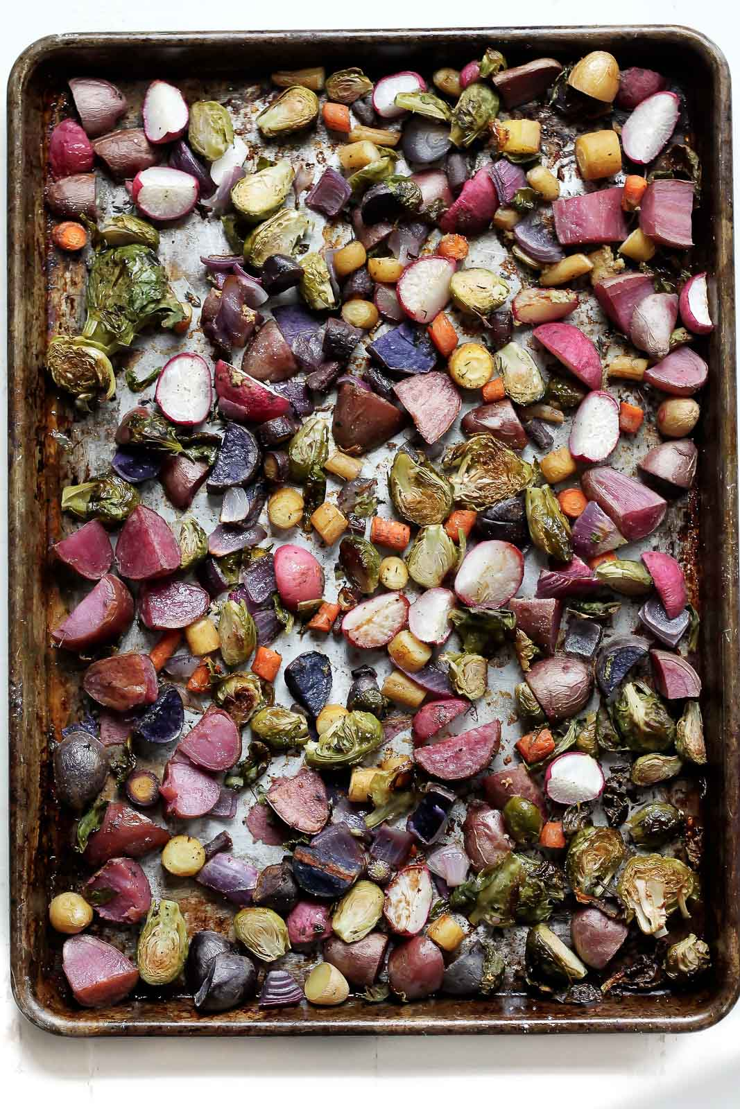 Rainbow veggies roasted to perfection with garlic, olive oil and turmeric, then drizzled with a sweet and spicy chipotle honey yogurt dressing. Throw in some quinoa or enjoy with grilled chicken or salmon as a main dish!