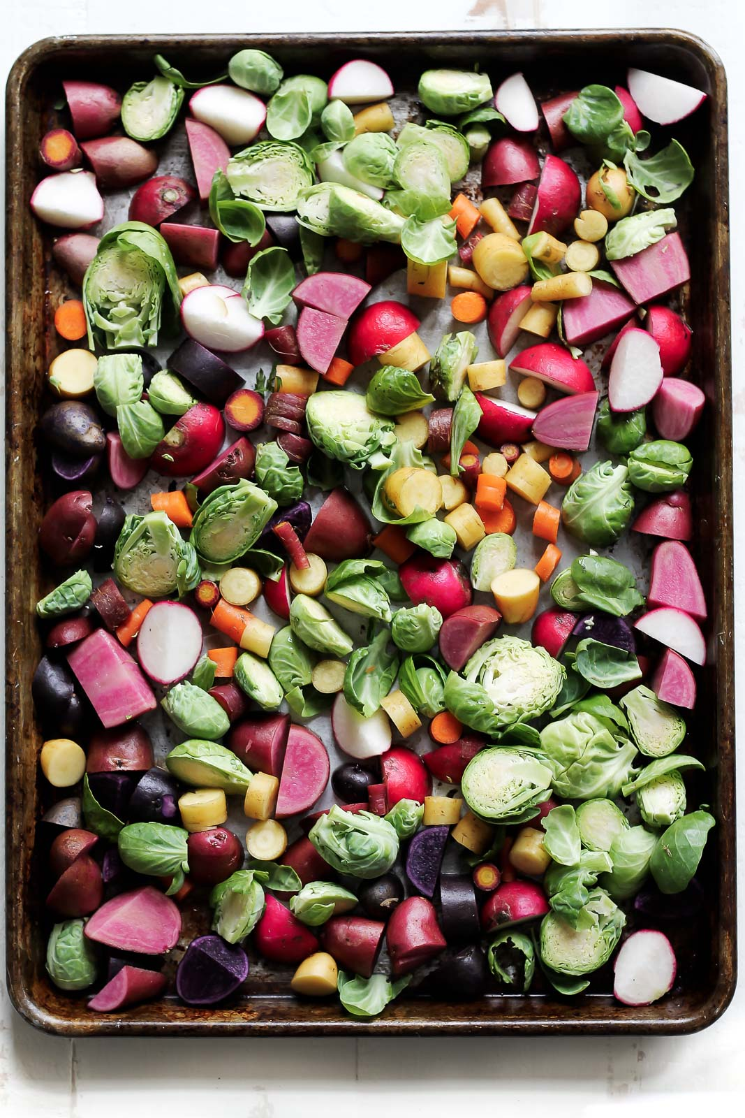 Rainbow veggies on a pan ready to roast