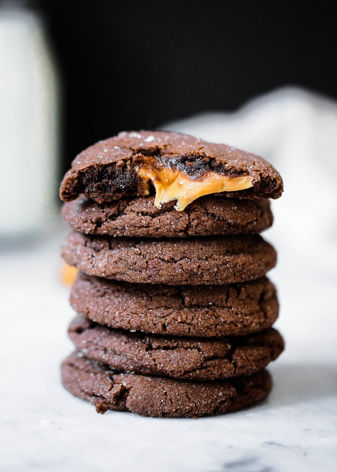 chocolate snickerdoodles stuffed with caramel in a stack