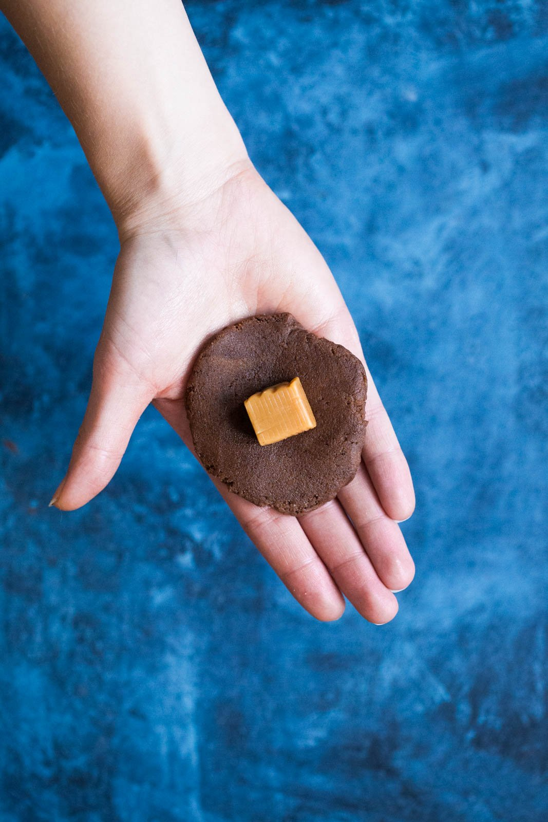 a caramel on top of chocolate snickerdoodle dough