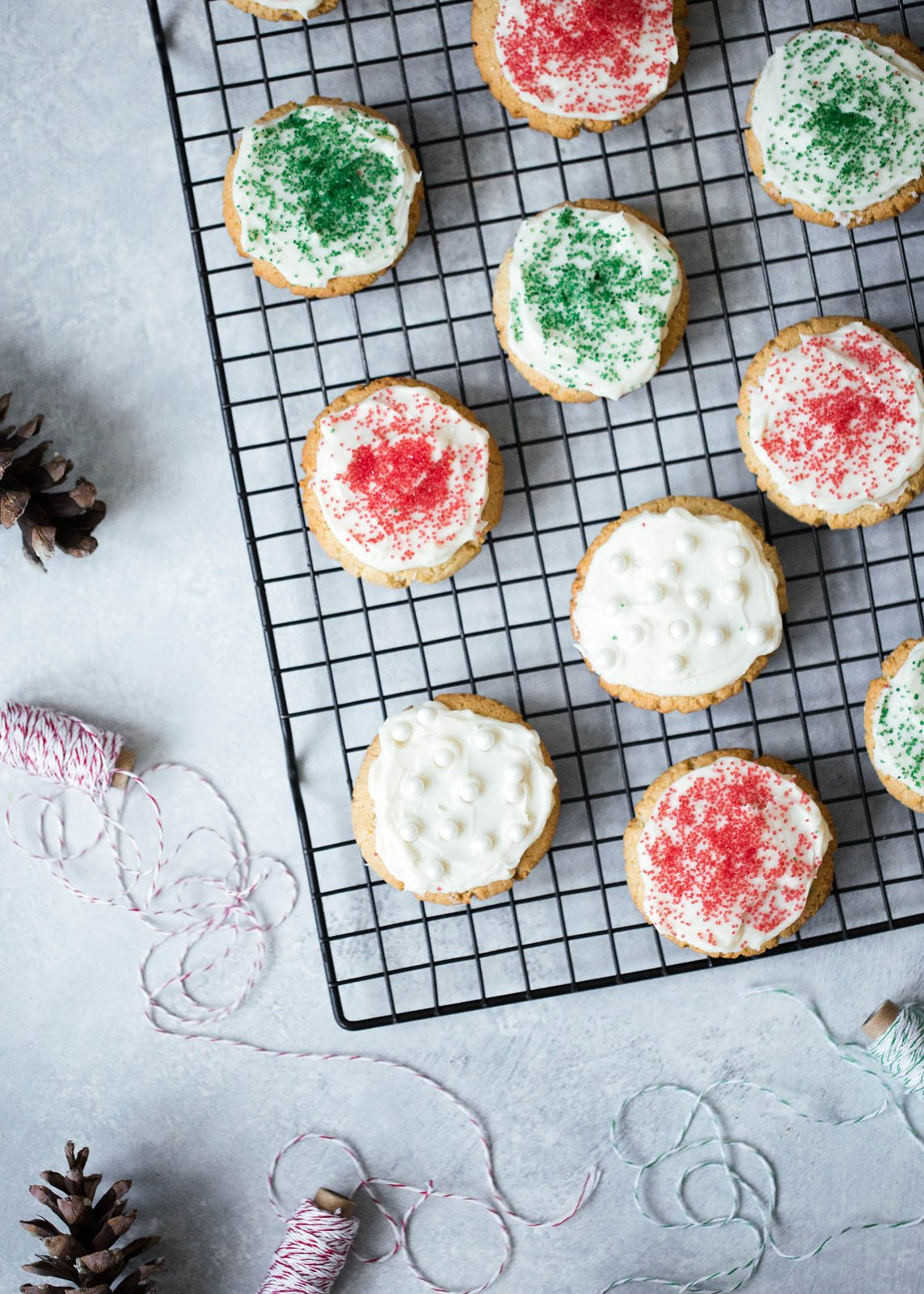 frosted almond flour sugar cookies on a wire rack