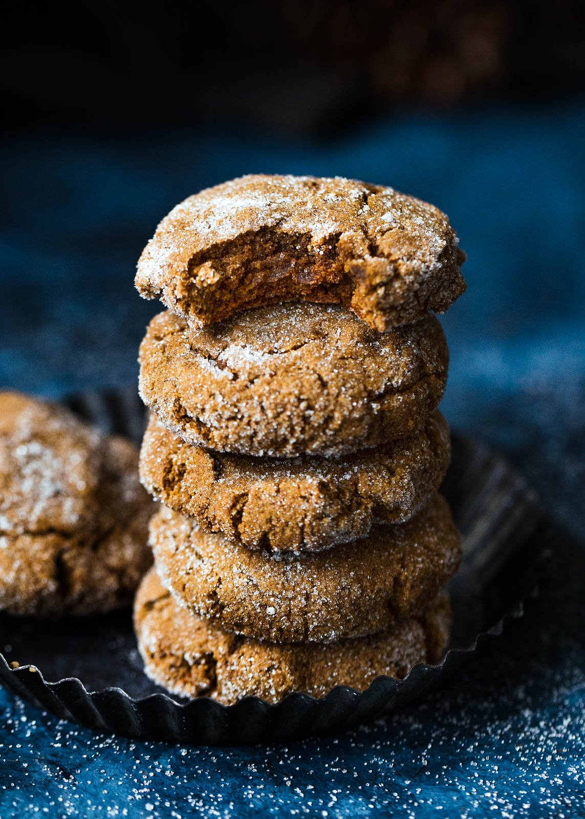 Soft paleo ginger molasses cookies in a stack