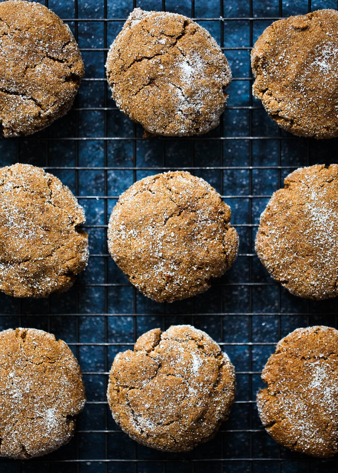 Soft paleo ginger molasses cookies on a wire rack