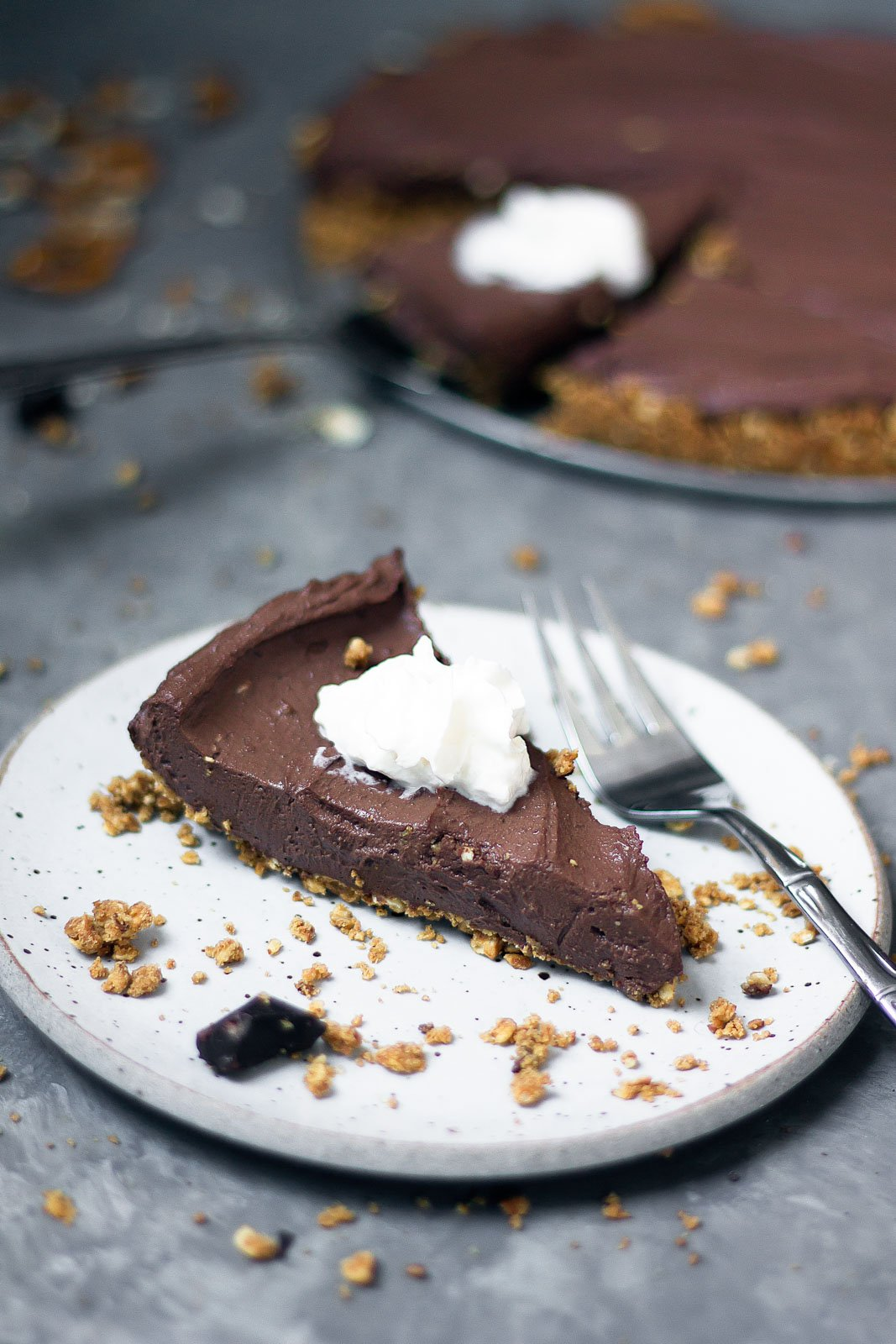 Creamy vegan chocolate tofu cheesecake with a sweet and salty peanut butter pretzel crust. Absolutely to die for & almost no bake!