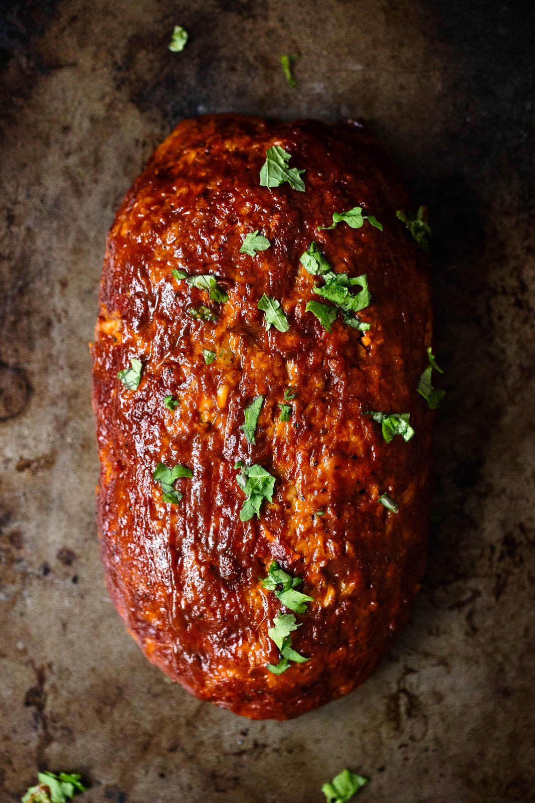 healthy sweet potato BBQ turkey meatloaf stuffed with cheese on a baking sheet