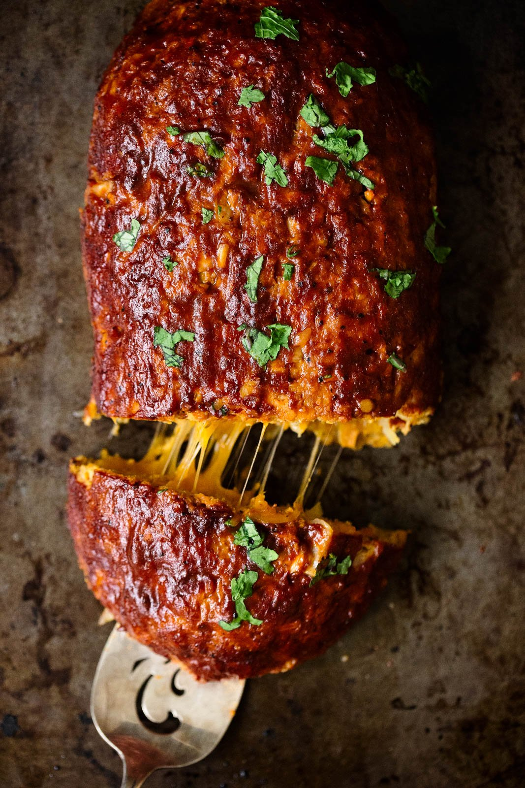 sweet potato BBQ turkey meatloaf stuffed with cheese on a baking sheet