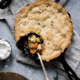healthy chicken pot pie in a skillet with a spoon