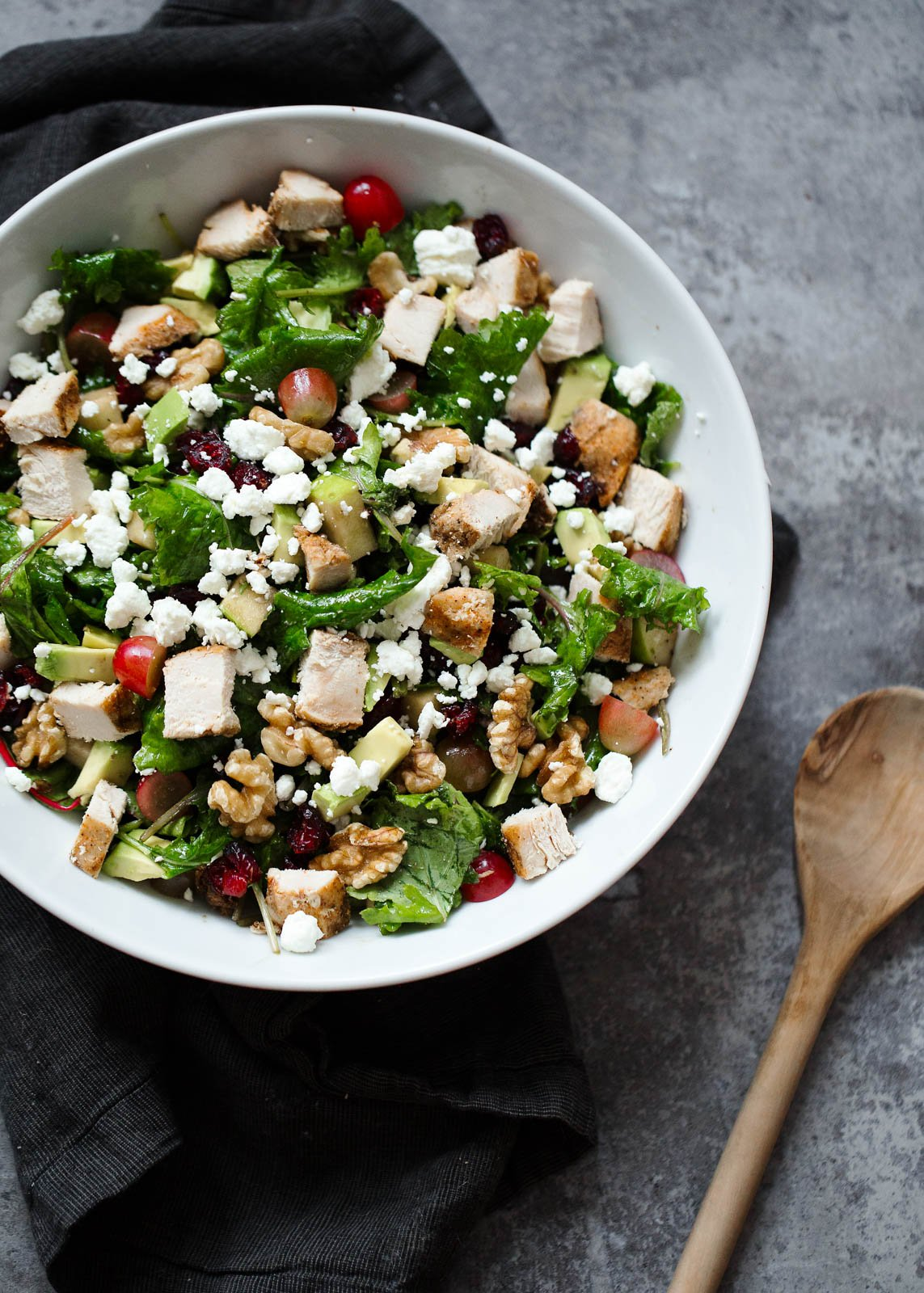 This fabulous kale waldorf salad has chopped chicken breast, avocado, goat cheese, tart cranberries and crunchy toasted walnuts. Tossed in an easy light balsamic vinaigrette.