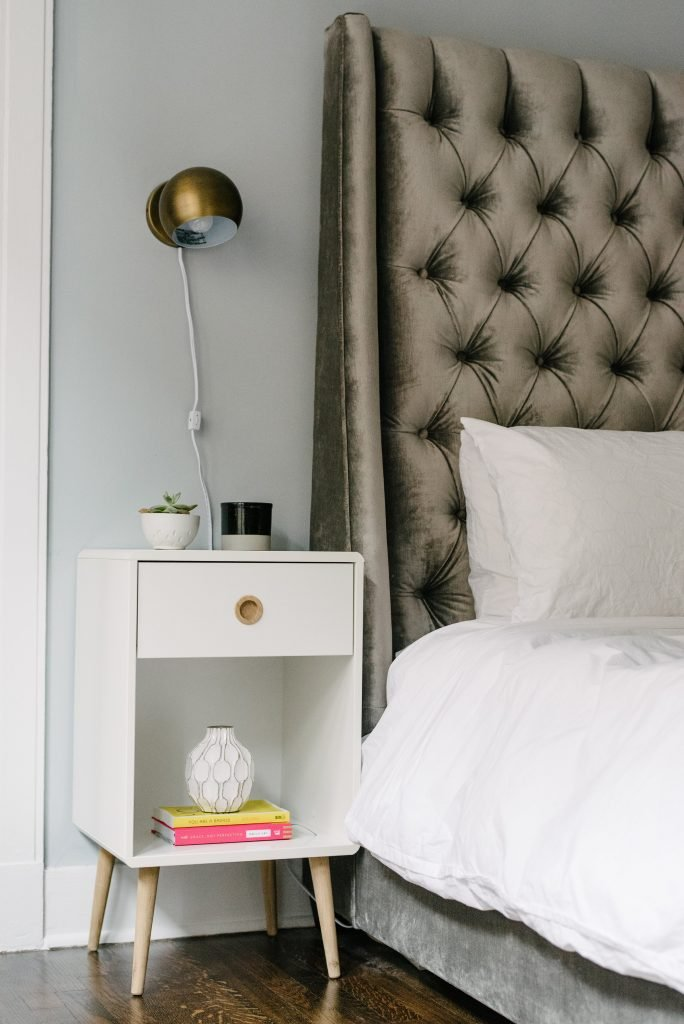 Bold, glam and modern master bedroom with white bedding and bronze/gold unique touches. So beautiful and unique! #ambitioushome