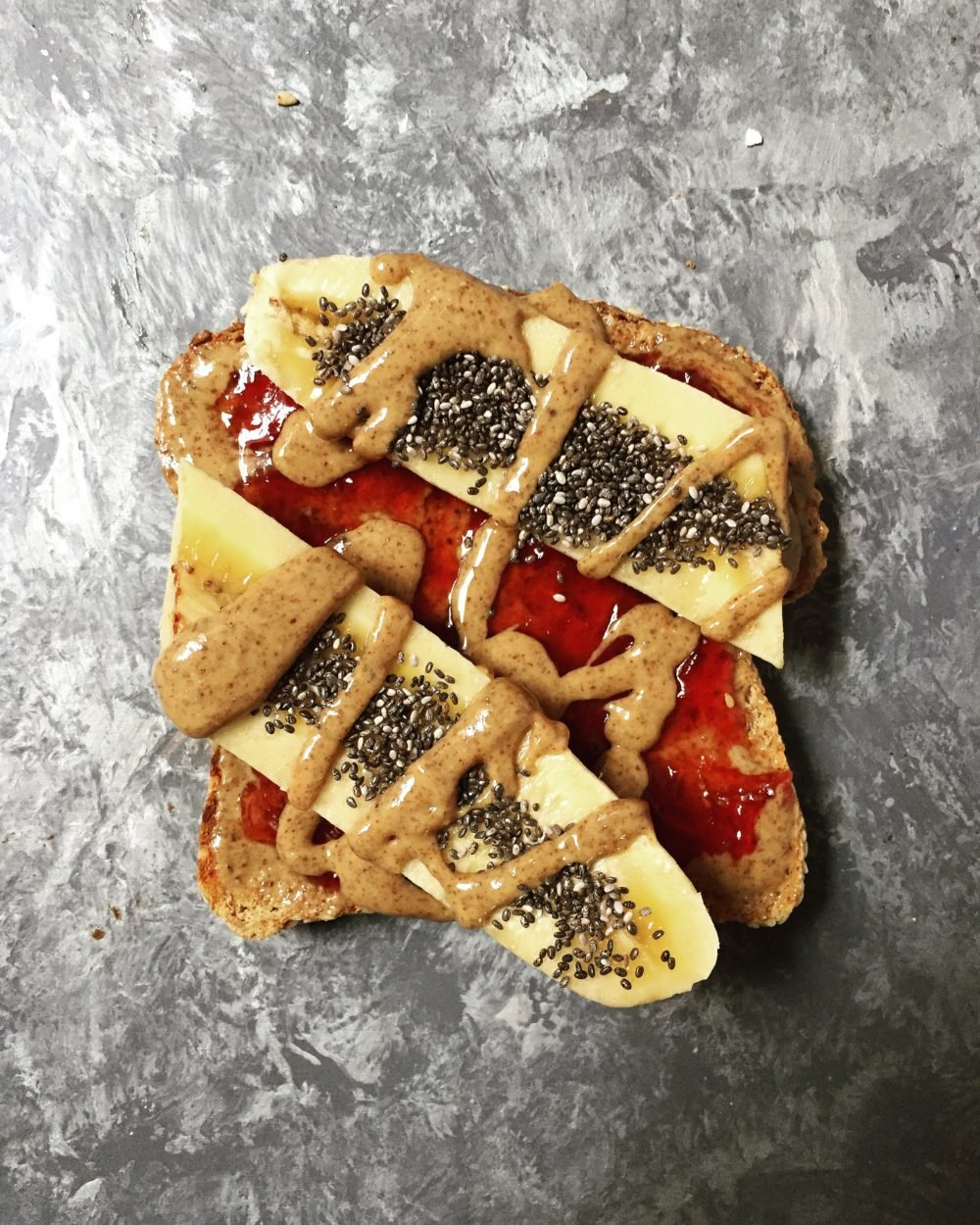 toast with peanut butter, jelly and banana slices