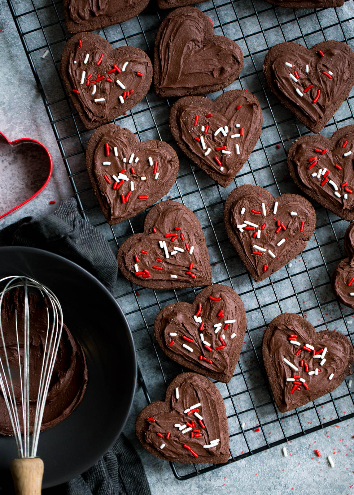chocolate sugar cookies cut into hearts on a wire rack