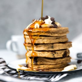banana bread pancakes being drizzled with syrup