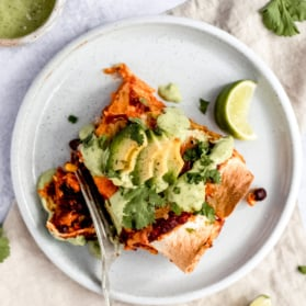 vegetarian sweet potato black bean enchiladas on a plate
