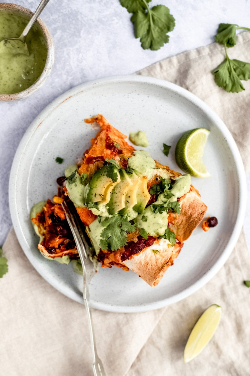 vegetarian enchiladas with sweet potato and black beans on a plate